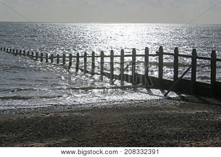 Groynes on Dawlish Warren Beach in Devon