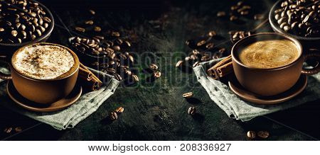 Background of two served cups with tasty steaming coffee composed with coffee beans.