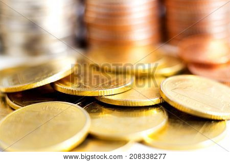 Close up golden coins on the table. The concept of business growth financial or money savings.