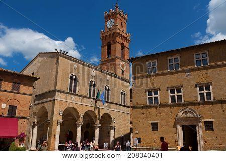 Pienza, Italy - May 27, 2017: Heritage buildings of Santa Maria Assunta Cathedral, Museo diocesano and Palazzo Piccolomini. - Val d'Orcia, Tuscany, Italy.