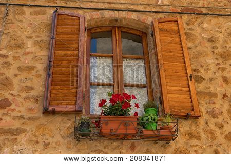 Pienza, Italy - May 27, 2017: Traditional façade of Italian house in the small magical and old village of Pienza, Val D'Orcia Tuscany - Italy