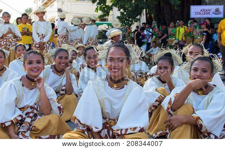 Dumaguete Philippines - 16 September 2017: Sandurot Festival actors resting before performance. Carnival with dancing in colorful costumes. Beautiful dancers smiling in camera. Philippines tradition