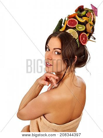 Hair mask from fresh fruits on woman head. Portrait in profile of girl with beautiful face. Back view. Acceleration of hair and eyebrows growth.