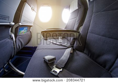Armchairs In Passenger Cabin, With Safety Belts And Portholes.