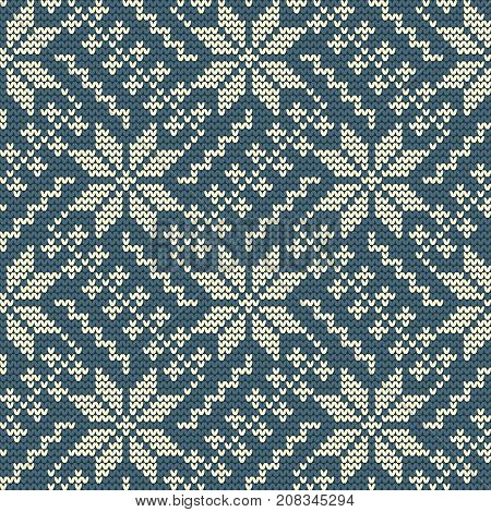 Knitted pattern on a blue background. Ornament. Seamless sample. It can be used as a background. Vector illustration.