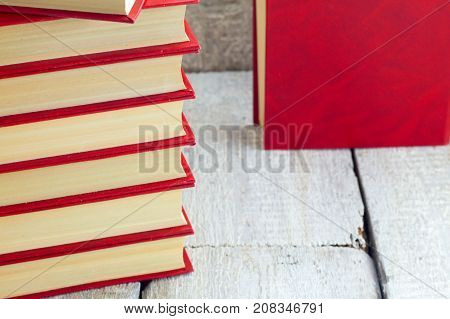 Old book on a wooden shelf. .