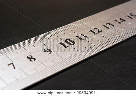 Metal ruler closeup. Measuring tool. Stationery. The number ten in focus. Centimeters. Millimeters.