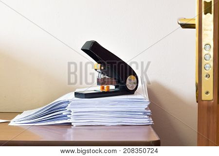 Stack Of Blank White Paper With Big Office Stepler