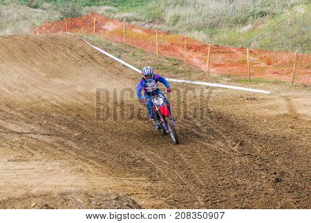 The Racer On A Motorcycle Participates In Race Motocrosses, Goes On Sand.