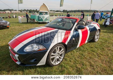 DUNSFOLD, UK - AUGUST 26: Special edition Jaguar XK drop-top convertible with GB flag paintwork at a gathering of vintage vehicles in Dunsfold, UK on August 26, 2017