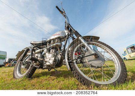 DUNSFOLD, UK - AUGUST 26: Wide-angle closeup of a vintage Royal Enfield off-road motorcycle at a gathering of classic and modern vehicles in Dunsfold, UK on August 26, 2017