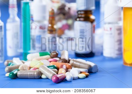 Capsule tablets and vials with medicines