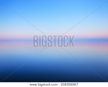 Tranquil Minimalist Landscape Of Calm Water And Horizon