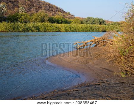 Landscape view over beautiful Kunene River which seperates Namibia and Angola, Southern Africa.