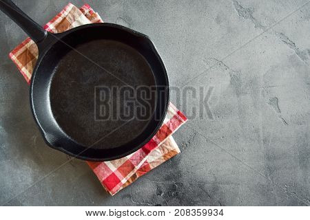 Cast Iron Pan On Concrete Background