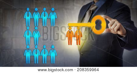 Unrecognizable HR manager is unlocking the potential of a work team with a virtual key with workers for key bit. Concept for team building talent management success solution and achievement.