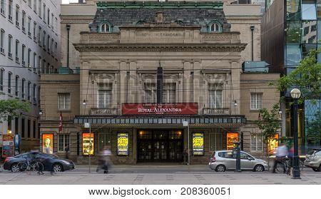 Toronto ON Canada June 2 2016 people and cars passing Royal Alexandra Theatre on King Street