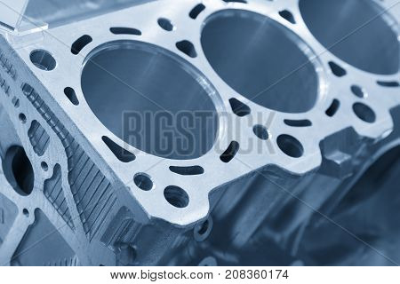 Close-up of the cylinder block in the light blue scene.Automotive partmachine part .