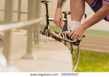 Sportsman Tying Shoe