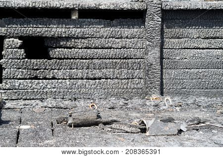 Burned charred planks on wood walll closeup in a fire