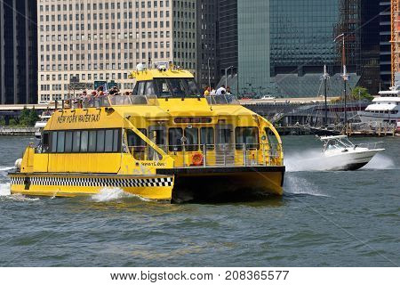 NEW YORK CITY - AUG. 27: NY Water Taxi on the Hudson River on August 27 2017 in New York City NY. Water taxi service based in New York City offering sightseeing and charter services.