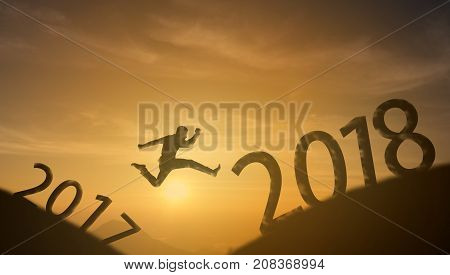 brave man successful conceptsilhouette man jumping over the sun between gap of the mountain from 2017 to 2018 new year it feel like a winner success finishreach a goal of live jobswork