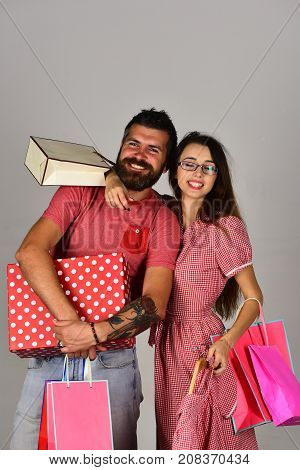 Guy With Beard And Girl With Smiling Faces Do Shopping.