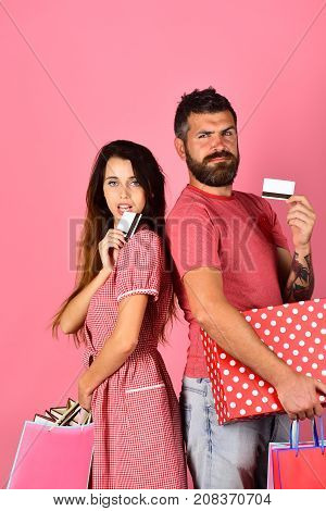 Shopping And Spending Concept. Couple In Love Holds Shopping Bags
