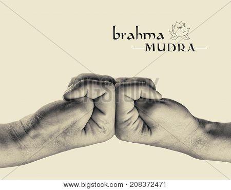 Brahma mudra. Yogic hand gesture. Isolated on toned background black and white.
