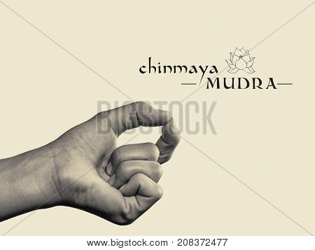 Chinmaya mudra. Yogic hand gesture. Isolated on toned background black and white.