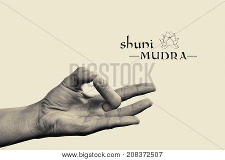 Shuni mudra. Yogic hand gesture. Isolated on toned background black and white.