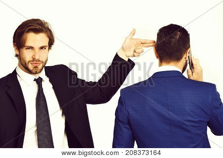 criminal business harassment diversion and sabotage corruption man with gun gesture shooting busy businessman speaking on phone in formal suit isolated on white background poster