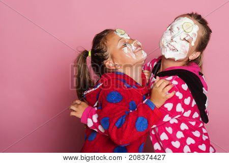 Girls In Colorful Bright Pajamas Hug, Have Fun