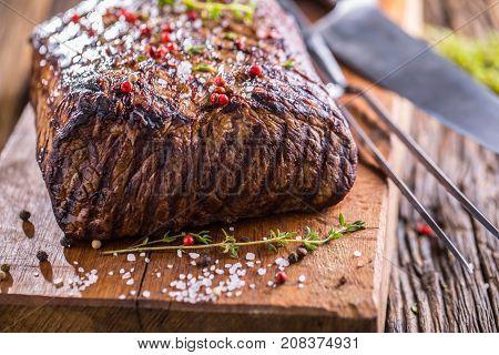 Beef Steak. Juicy Rib Eye Steak In Pan On Wooden Board With Herb And Pepper