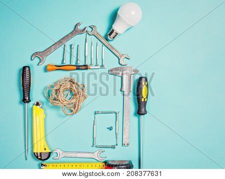 Home improvement concept. Set work hand tool for construction or repair of house. Rebuilding DIY. Group of tools in shape house.