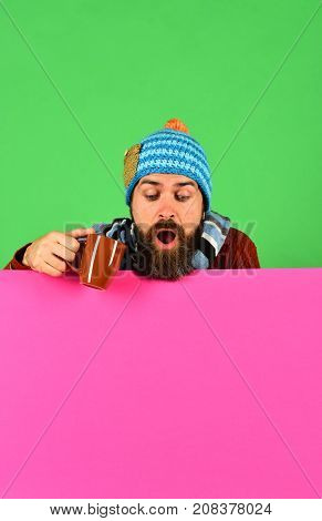 Hipster With Beard And Shocked Face Has Tea Or Coffee.