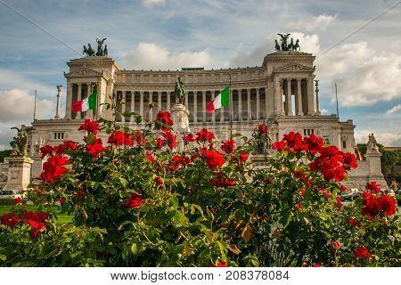 ROME, ITALY - OCTOBER 10, 2017: Piazza Venezia, National Monument to Vittorio Emanuele II crowded with red roses, Rome