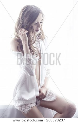 Young Adult Fashionable Woman In Sexy White Underwear And Nightie, Sit On Window Sill And Touching H