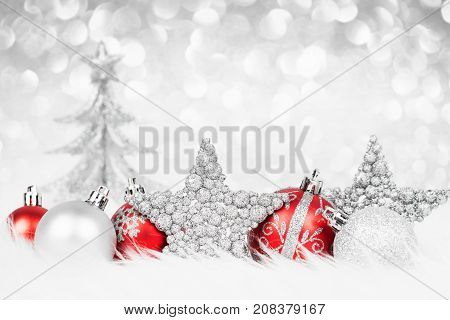 Colorful christmas decoration on snow close-up. Xmas card