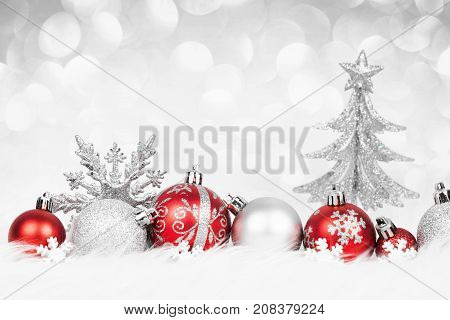 Christmas red balls with silver decoration on the snow. Xmas card