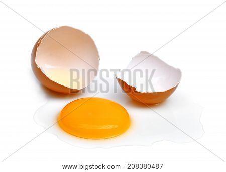 cracked egg with egg shell egg yolk and egg white isolated on white background