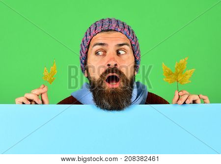 Hipster With Beard And Playful Face Wears Warm Clothes.