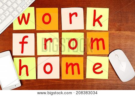 work from home written on adhesive notes top view of modern desk