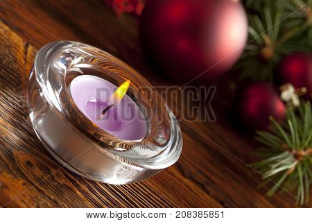Candle And Christmas Baubles And Tree