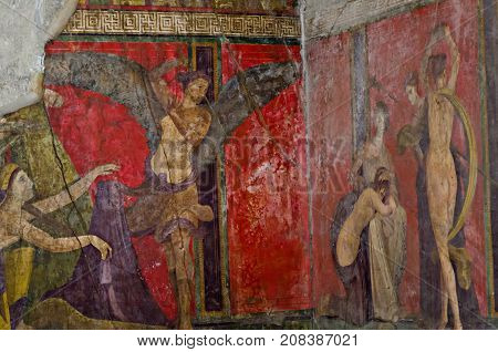 Ancient Roman fresco in Pompeii showing a detail of the mystery cult of Dionysus. Pompeii was destroyed, during a catastrophic eruption of the volcano Vesuvius spanning in AD 79.