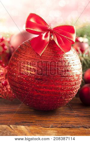Christmas bauble with red bow on table