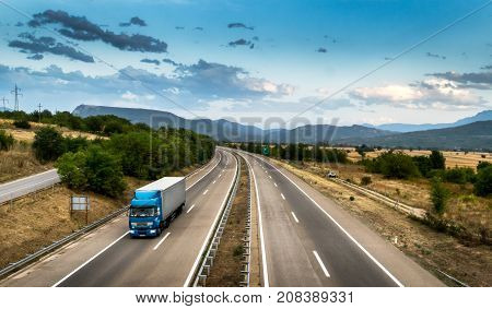Blue truck in motion on the highway