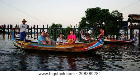 People On Wooden Boats In Mandalay, Myanmar