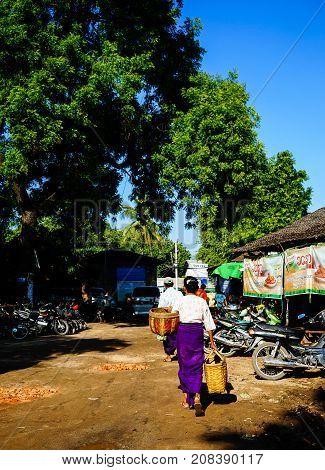 People Walking On Street In Yangon, Myanmar