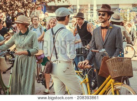 KYIV, UKRAINE - SEP 17, 2017: Group of young men in vintage clothing talking about sport and fashion at cosplay festival Retro Cruise on September 17, 2017. Kiev is the 8th most populous city in Europe